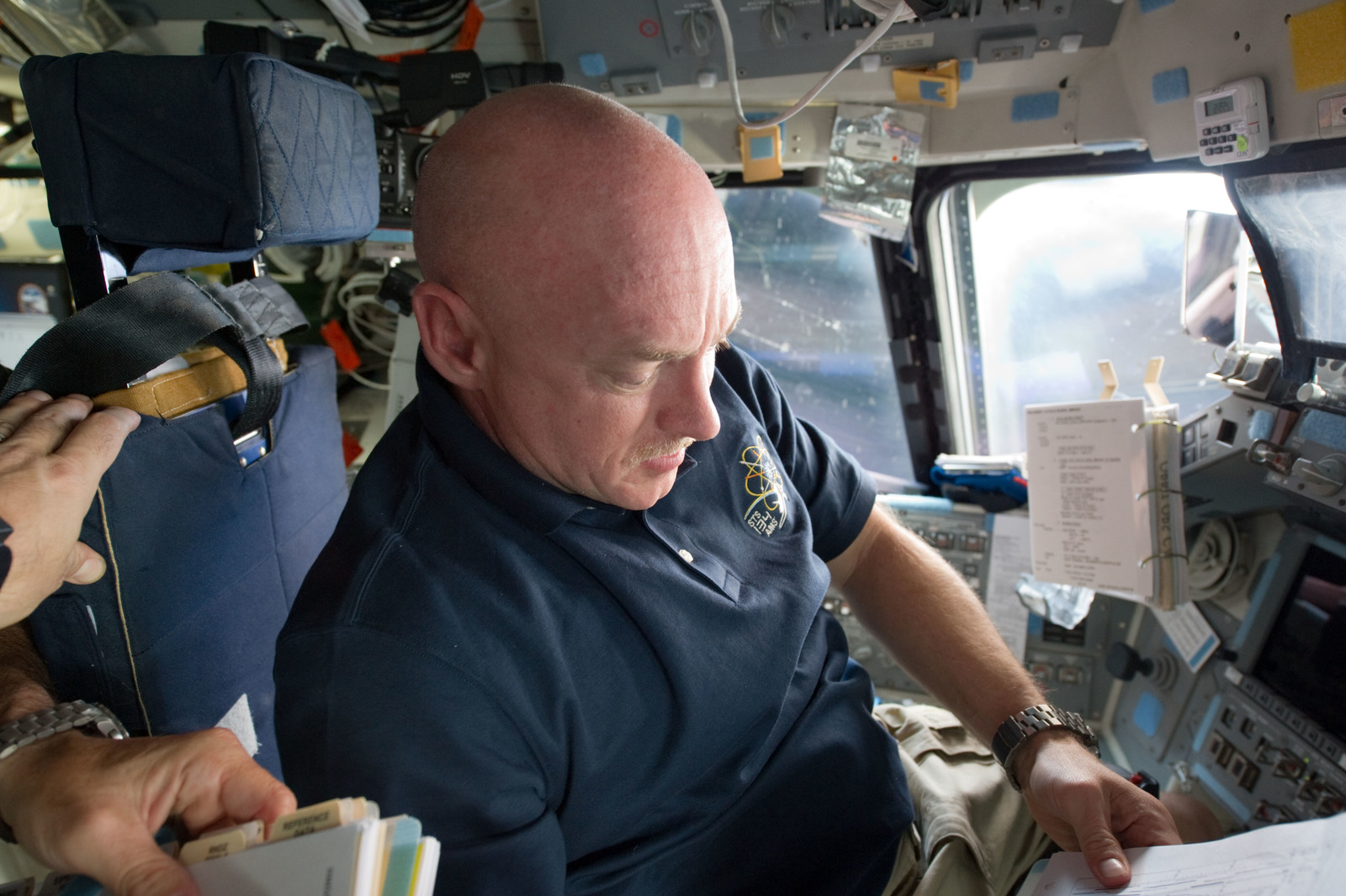 S134E006539 - STS-134 - STS-134 Commander Kelly working on the Flight Deck
