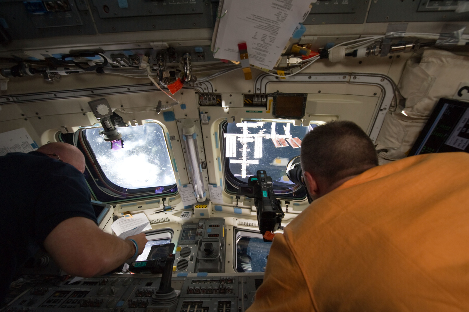 S134E006992 - STS-134 - View of STS-134 Crew Members on the Flight Deck