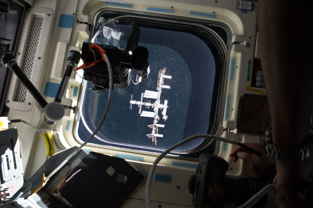 S134E007030 - STS-134 - View of the ISS as seen through a Flight Deck Window