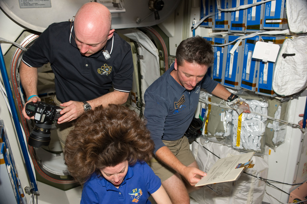 S134E008399 - STS-134 - View of Expedition 27 / STS-134 Crew Members in the Node 1