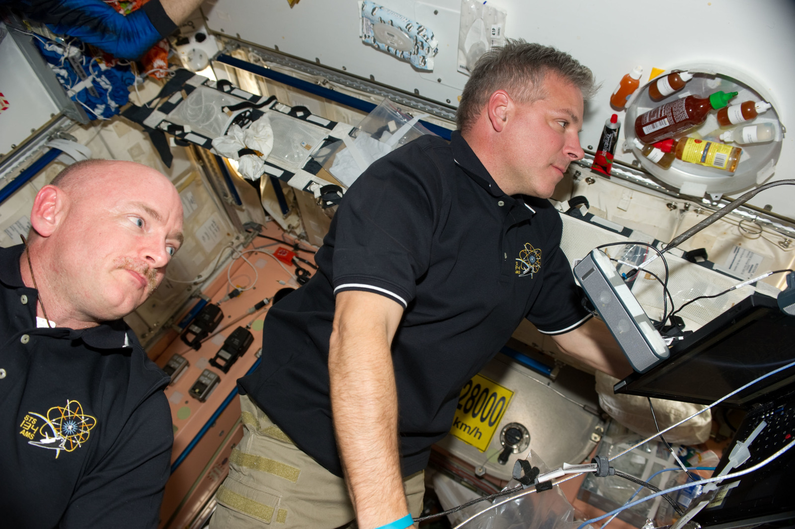 S134E008430 - STS-134 - STS-134 Crew Members in the Node 1
