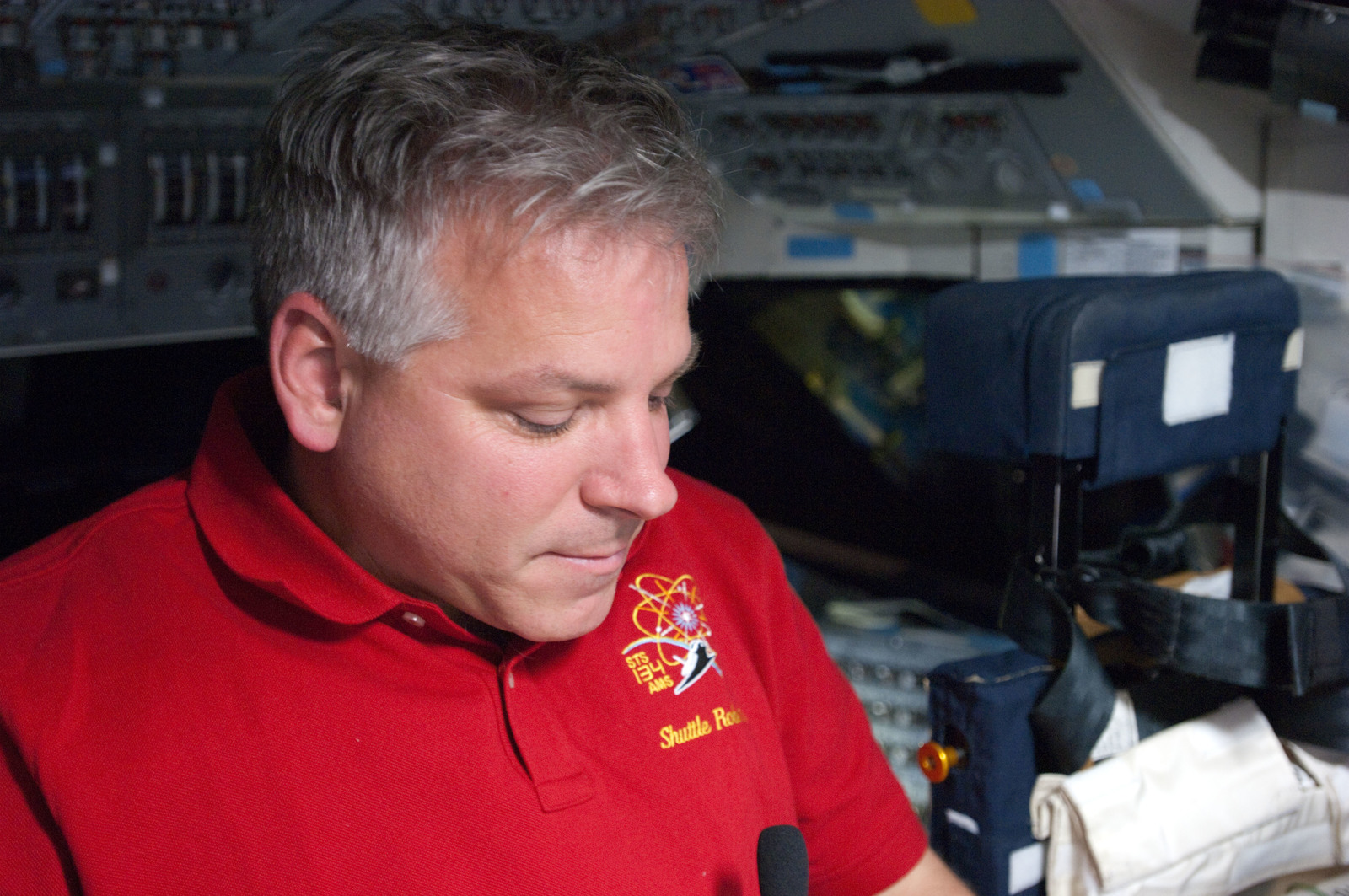 S134E009335 - STS-134 - View of STS-134 Pilot Johnson working on the Flight Deck