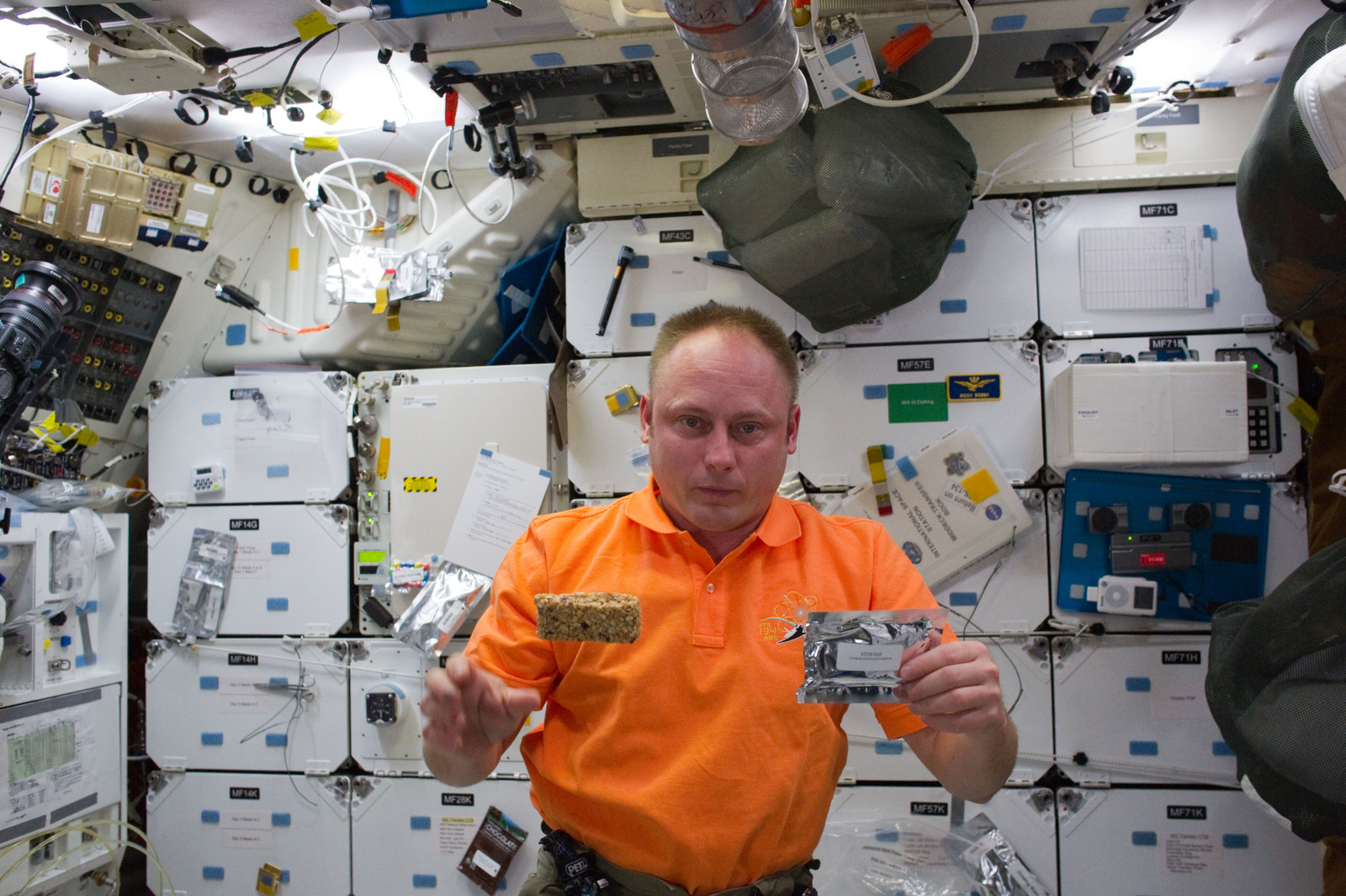 S134E009701 - STS-134 - STS-134 MS Fincke poses for a photo with a STEM Bar