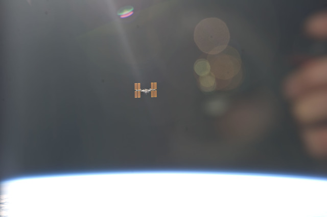 S134E010981 - STS-134 - View of ISS taken as the Shuttle left after Undocking