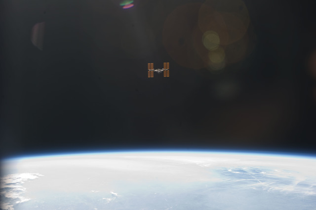 S134E010983 - STS-134 - View of ISS taken as the Shuttle left after Undocking