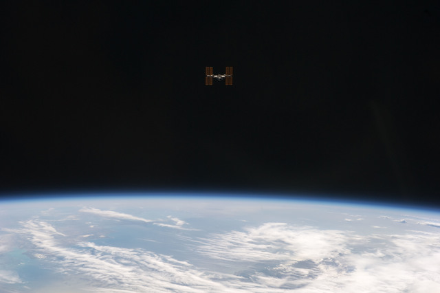 S134E010998 - STS-134 - View of ISS taken as the Shuttle left after Undocking