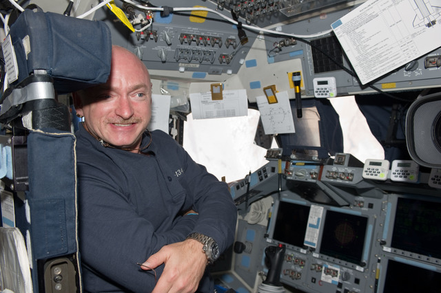 S134E011003 - STS-134 - STS-134 Commander Kelly poses for a photo on Flight Deck