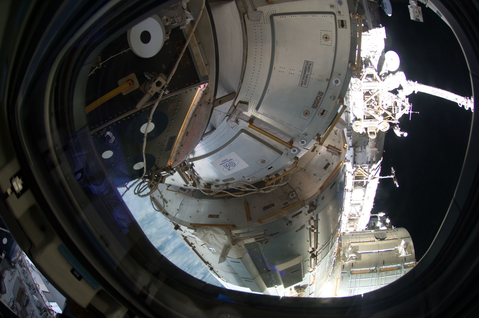 S134E011360 - STS-134 - Exterior view of the ISS as seen through a Shuttle Endeavour Window