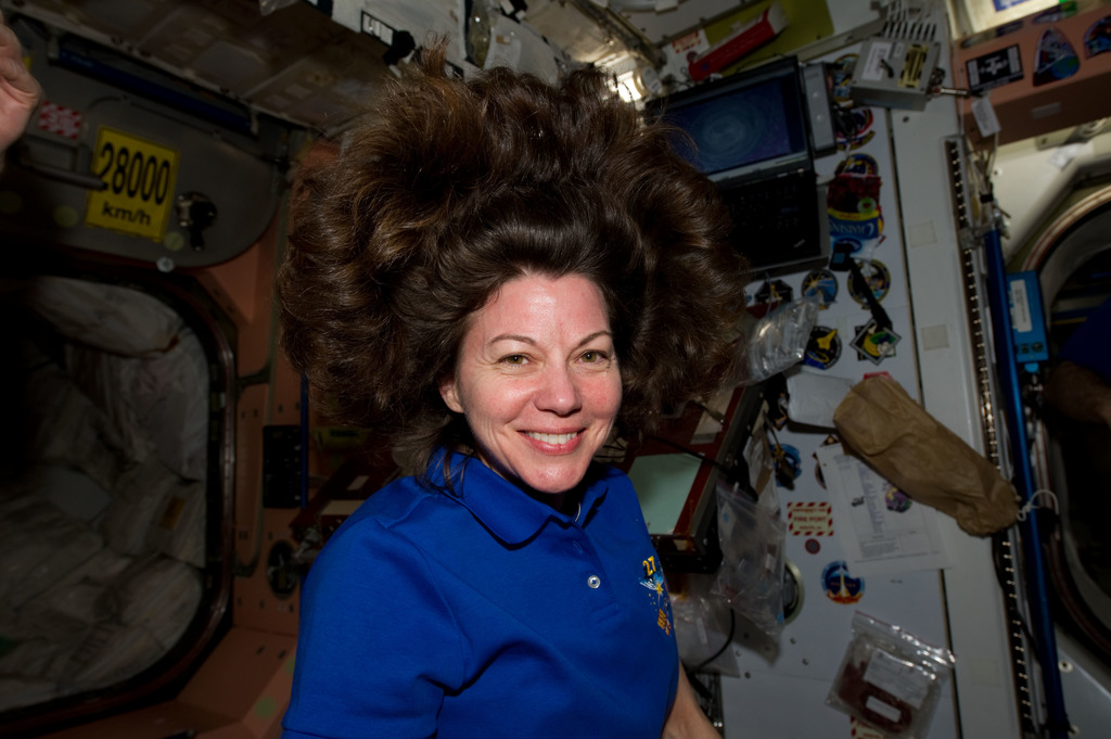 S134E011984 - STS-134 - View of Expedition 27 FE Coleman in the Node 1