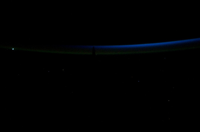 S134E012356 - STS-134 - View of Sun Rising from behind Earth's Horizon