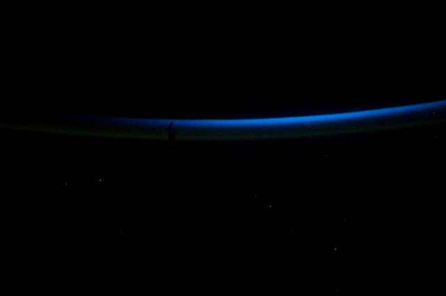S134E012359 - STS-134 - View of Sun Rising from behind Earth's Horizon