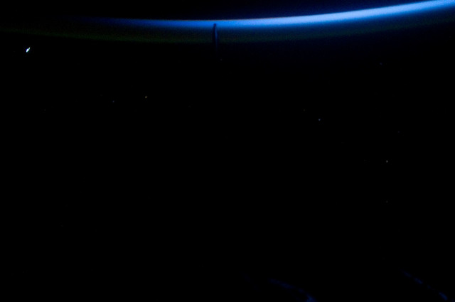 S134E012365 - STS-134 - View of Sun Rising from behind Earth's Horizon