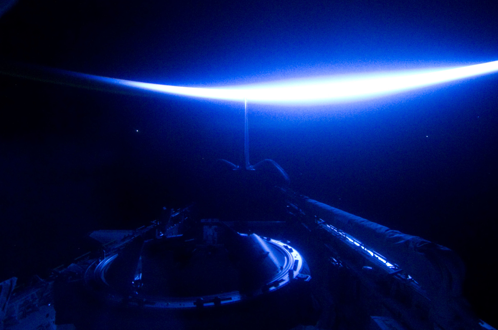 S134E012414 - STS-134 - View of Sun Rising from behind Earth's Horizon