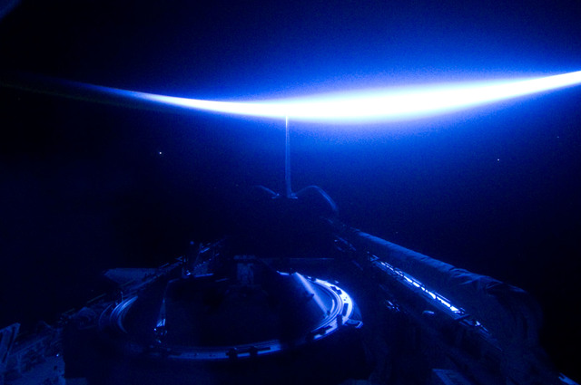 S134E012415 - STS-134 - View of Sun Rising from behind Earth's Horizon