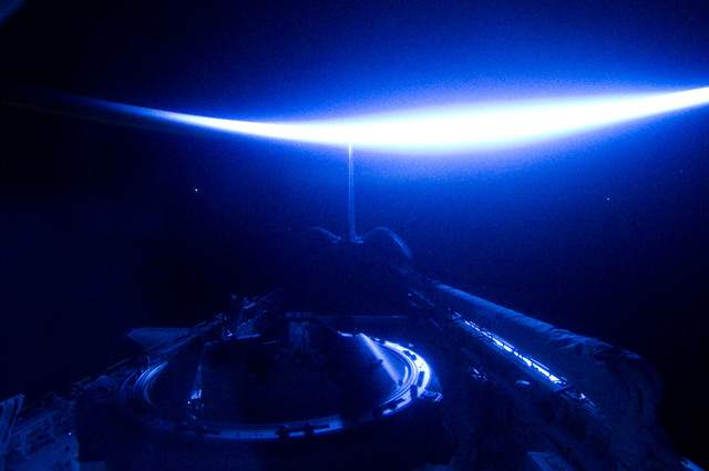 S134E012421 - STS-134 - View of Sun Rising from behind Earth's Horizon