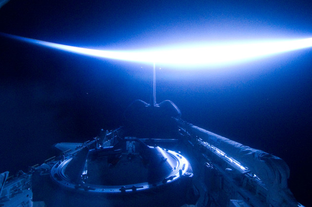 S134E012468 - STS-134 - View of Sun Rising from behind Earth's Horizon
