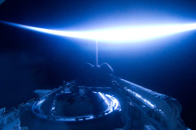S134E012479 - STS-134 - View of Sun Rising from behind Earth's Horizon