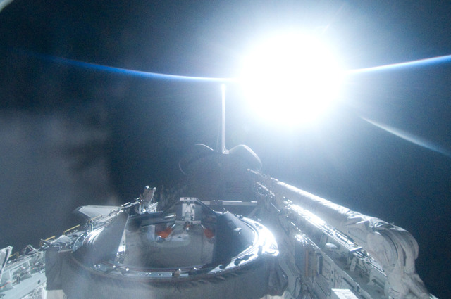 S134E012506 - STS-134 - View of Sun Rising from behind Earth's Horizon