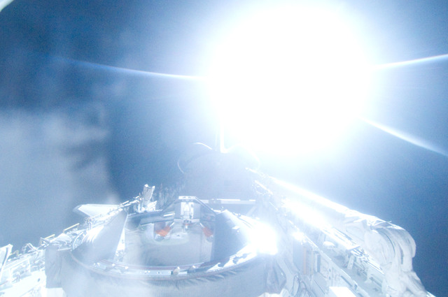 S134E012509 - STS-134 - View of Sun Rising from behind Earth's Horizon