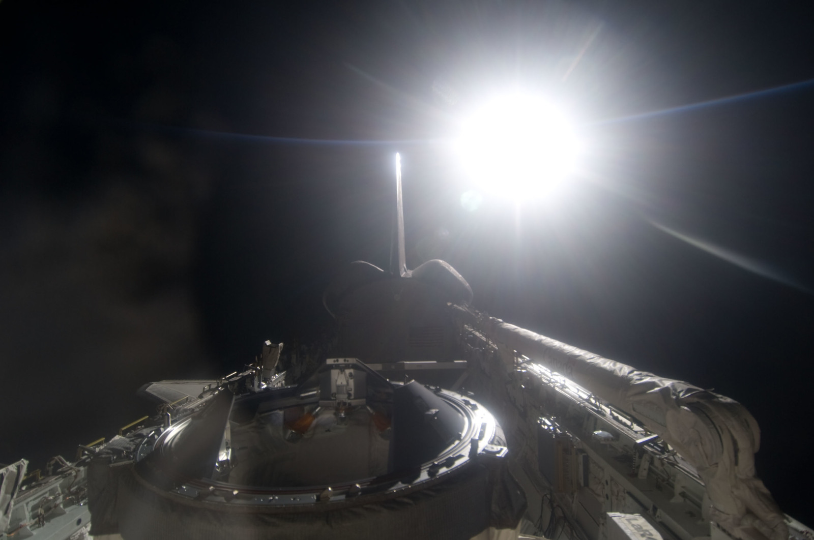 S134E012510 - STS-134 - View of Sun Rising from behind Earth's Horizon