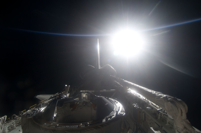 S134E012523 - STS-134 - View of Sun Rising from behind Earth's Horizon