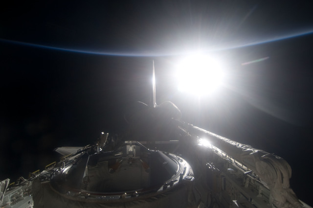 S134E012549 - STS-134 - View of Sun Rising from behind Earth's Horizon