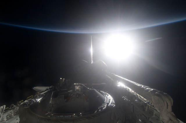 S134E012562 - STS-134 - View of Sun Rising from behind Earth's Horizon