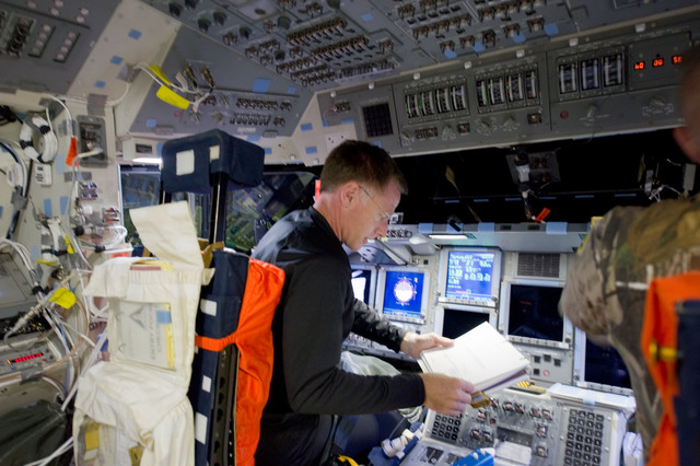 S135E006170 - STS-135 - Ferguson on Flight Deck