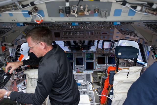 S135E006180 - STS-135 - Ferguson on Aft Flight Deck