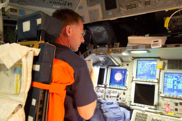 S135E006285 - STS-135 - Ferguson on FWD Flight Deck