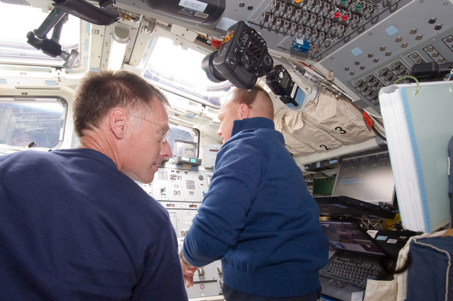 S135E006309 - STS-135 - Ferguson and Hurley on Aft Flight Deck