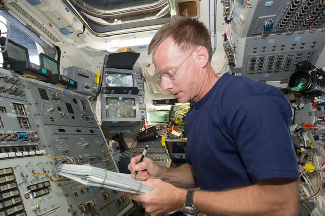 S135E006395 - STS-135 - Ferguson on Aft Flight Deck