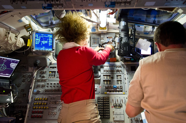 S135E007118 - STS-135 - Magnus and Walheim on Atlantis Aft Flight Deck during Rendezvous OPS