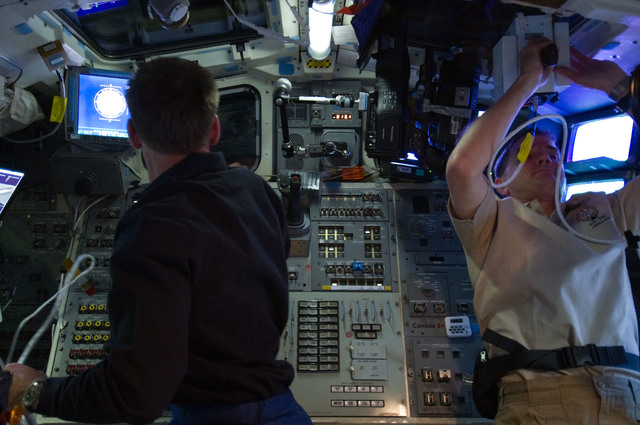 S135E007199 - STS-135 - Ferguson and Walheim on Atlantis Aft Flight Deck during Rendezvous OPS