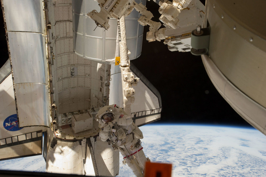 S135E007599 - STS-135 - Fossum conducts Photo OPS during EVA 1