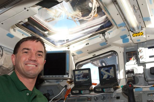 S135E007667 - STS-135 - Walheim on aft Flight Deck during EVA 1