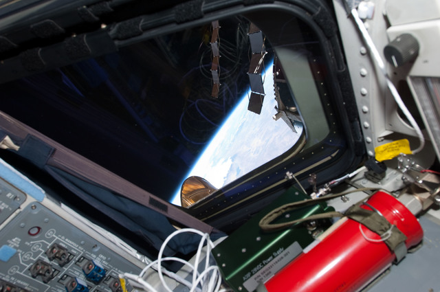 S135E008180 - STS-135 - View of a Window on the Atlantis Flight Deck