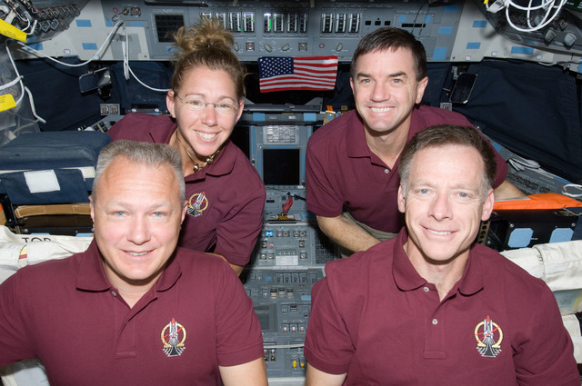 S135E008711 - STS-135 - In-Flight Portrait of the STS-135 Crew on the Atlantis Flight Deck