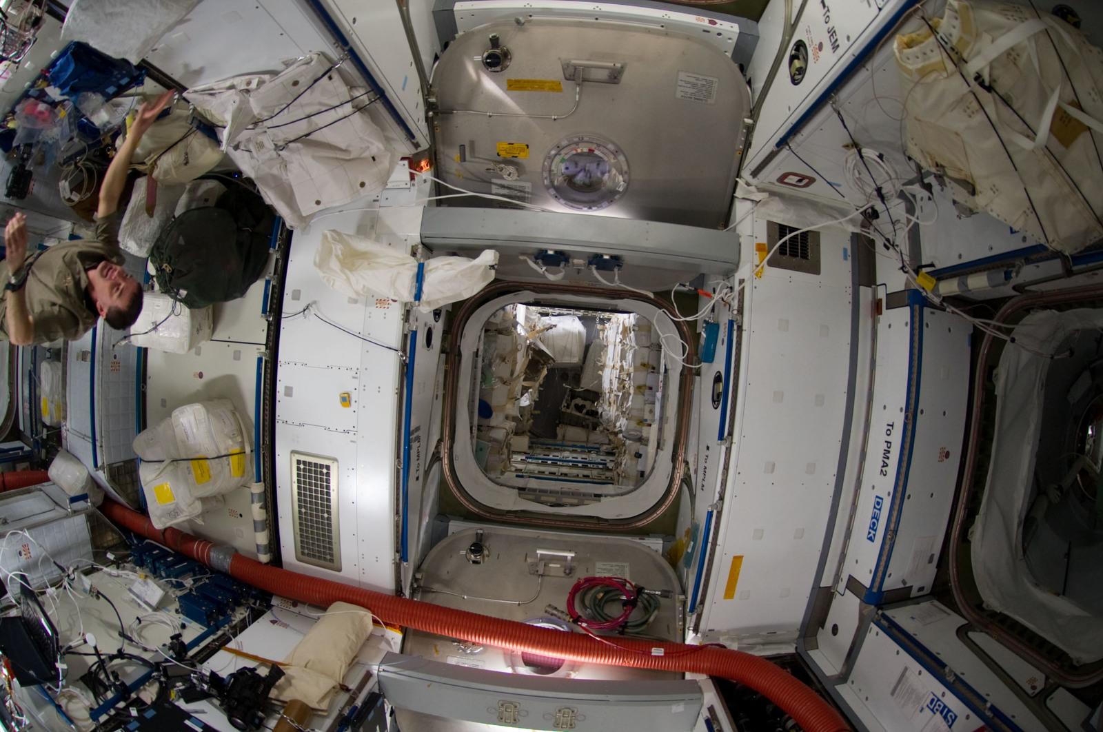 S135E009133 - STS-135 - Walheim floats into Node 2