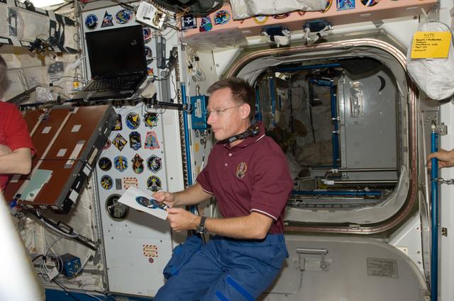 S135E009444 - STS-135 - Ferguson in Node 1