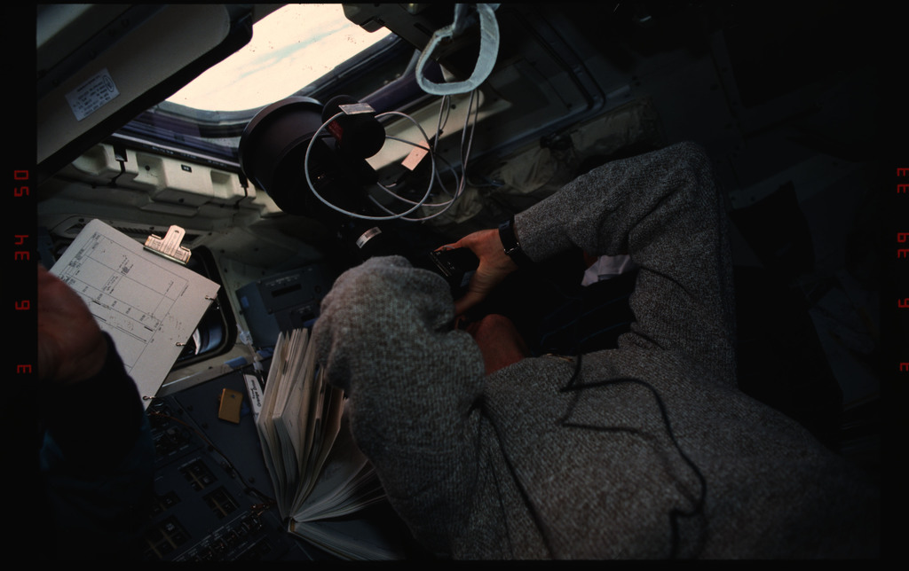 S35-11-012 - STS-035 - STS-35 dummy astronauts set up on OV-102's aft flight deck