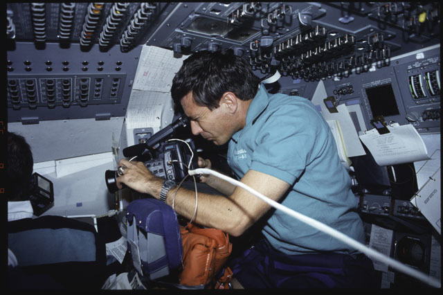 S43-04-031 - STS-043 - STS-43 Commander Blaha works with a video camera on OV-104's flight deck