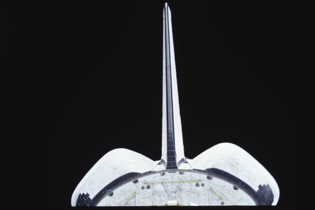 S43-07-004 - STS-043 - Views of OV-104's tail assembly and OMS pods taken during STS-43