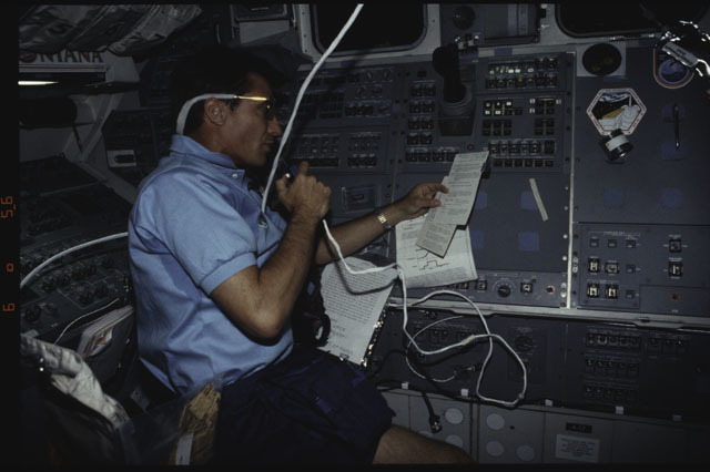 S43-39-005 - STS-043 - STS-43 Blaha speaks into a microphone on OV-104's flight deck