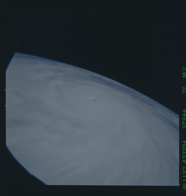 S44-72-102 - STS-044 - Earth limb view of super typhoon Yuri taken during the STS-44 mission