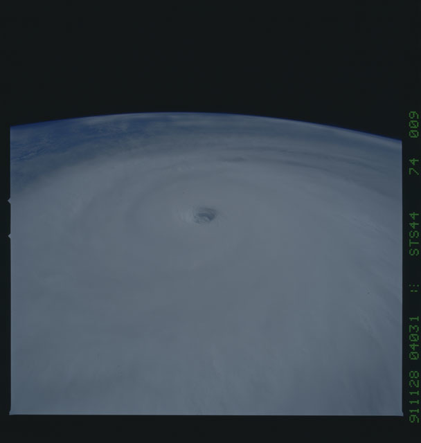 S44-74-009 - STS-044 - Earth limb view of super typhoon Yuri taken during the STS-44 mission