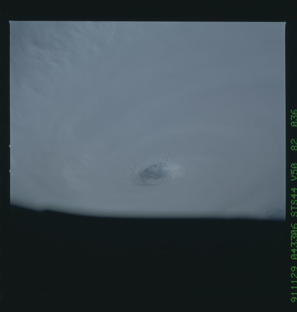 S44-82-036 - STS-044 - Earth limb view of super typhoon Yuri taken during the STS-44 mission
