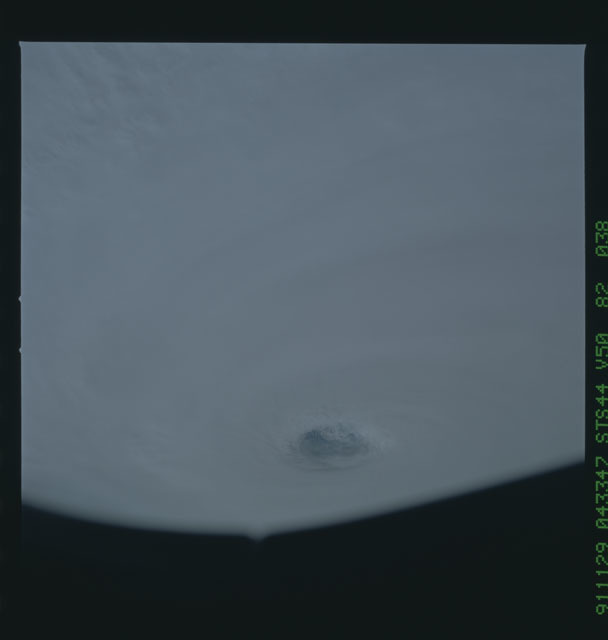 S44-82-038 - STS-044 - Earth limb view of super typhoon Yuri taken during the STS-44 mission