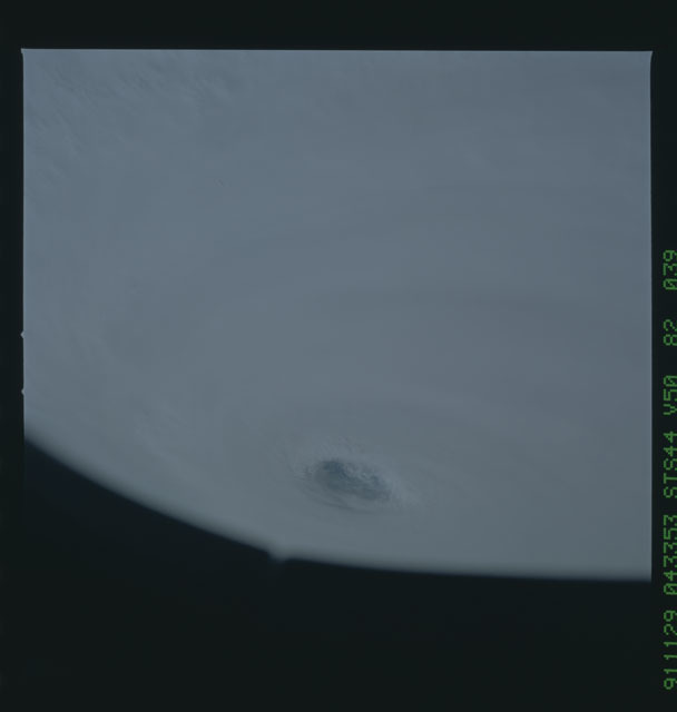 S44-82-039 - STS-044 - Earth limb view of super typhoon Yuri taken during the STS-44 mission