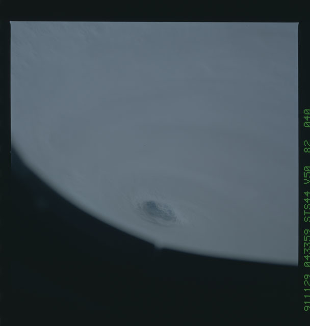 S44-82-040 - STS-044 - Earth limb view of super typhoon Yuri taken during the STS-44 mission